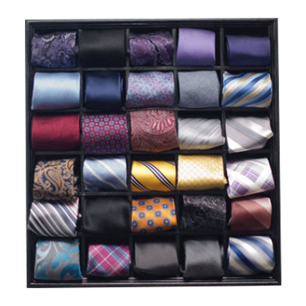 Rolled silk necktie storage container that fits in the drawer or the closet.