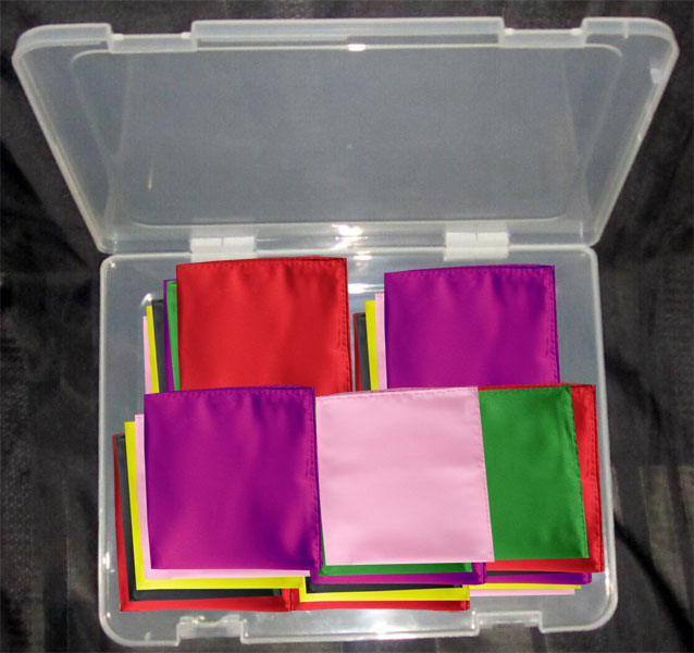 Storing silk pocket squares in a plastic container.