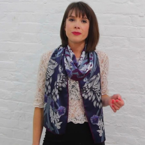 Wearing a womens long silk neck scarf for a casual look.