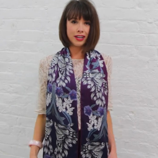 Wearing a womens long silk neck scarf for a colorful look.