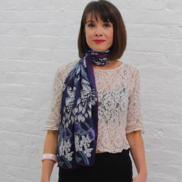 Wearing a womens long silk neck scarf for an elegant look.